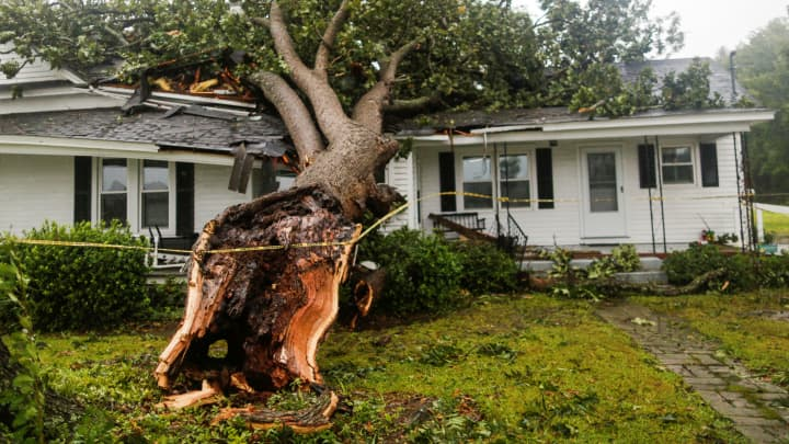 A downed tree rests on a house during the passing of Hurricane Florence in the town of Wilson, North Carolina, U.S. September 14, 2018.