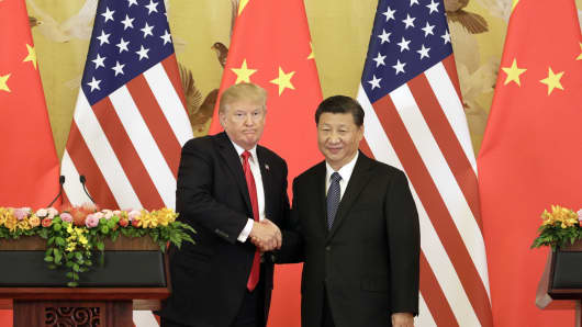 U.S. President Donald Trump (L) and Xi Jinping (R) , China's president, shake hands during a news conference at the Great Hall of the People in Beijing, China, on Thursday, Nov. 9, 2017.