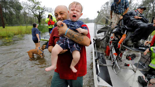 Oliver Kelly, 1 year old, cries as he is carried off the sheriff's airboat during his rescue from rising flood waters in the aftermath of Hurricane Florence in Leland, North Carolina, September 16, 2018.
