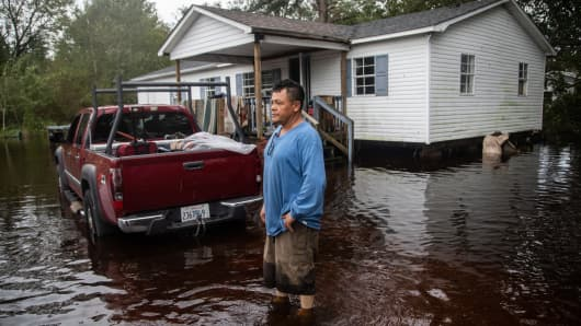 A man in front of a flooded home on Will Baker Road in Kinston, North Carolina on Sunday, Sept. 16, 2018 following the aftermath of Hurricane Florence.