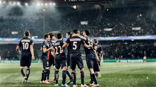 Marquinhos of Paris Saint-Germain #5 celebrates with team mates as he scores their first goal during the UEFA Champions League Round of 16 second leg match between Paris Saint-Germain FC and Bayer Leverkusen at Parc des Princes on March 12, 2014