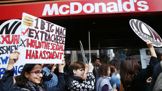 Protesters demonstrate outside of a McDonald's restaurant near Times Square after charges were brought against the company that they have ignored serious instances of sexual harassment on October 6, 2016 in New York City.