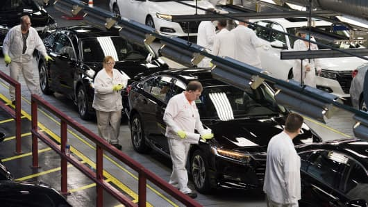 Employees perform quality control inspections on Honda Accord vehicles at the Honda of America Manufacturing Marysville Auto Plant in Marysville, Ohio, on Dec. 21, 2017.