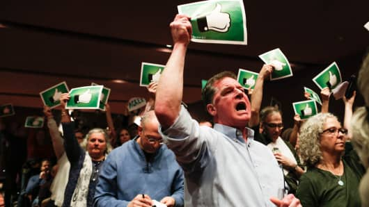 BRANCHBURG, NJ - FEBRUARY 25: Constituents react after U.S. Congressman Leonard Lance (R-NJ 7) responded to questions during a town hall event at the Edward Nash Theater on the campus of Raritan Valley Community College on February 25, 2017 in Branchburg, New Jersey. Protesters have been showing up in large numbers to congressional town hall meetings across the nation.