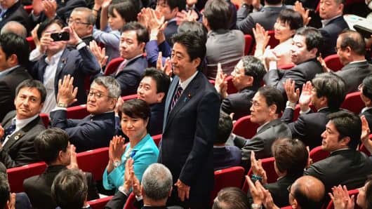 Japan's Prime Minister Abe wins party vote, on track for extended term
