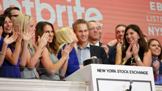 Eventbrite CEO Julia Hartz (C) and her husband Kevin Hartz, Co-Founder and Chairman of Eventbrite ring the opening bell at the New York Stock Exchange, September 20, 2018.