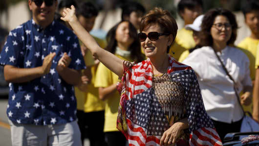 Young Kim, Republican U.S. Representative candidate from California, waves during a Fourth of July parade in Hacienda Heights, California, on Wednesday, July 4, 2018.