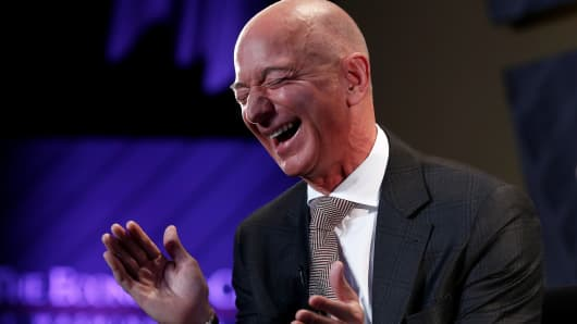 "Jeff Bezos, president and CEO of Amazon and owner of The Washington Post, laughs during an interview at the Economic Club of Washington DC's ""Milestone Celebration Dinner"" in Washington, U.S., September 13, 2018."