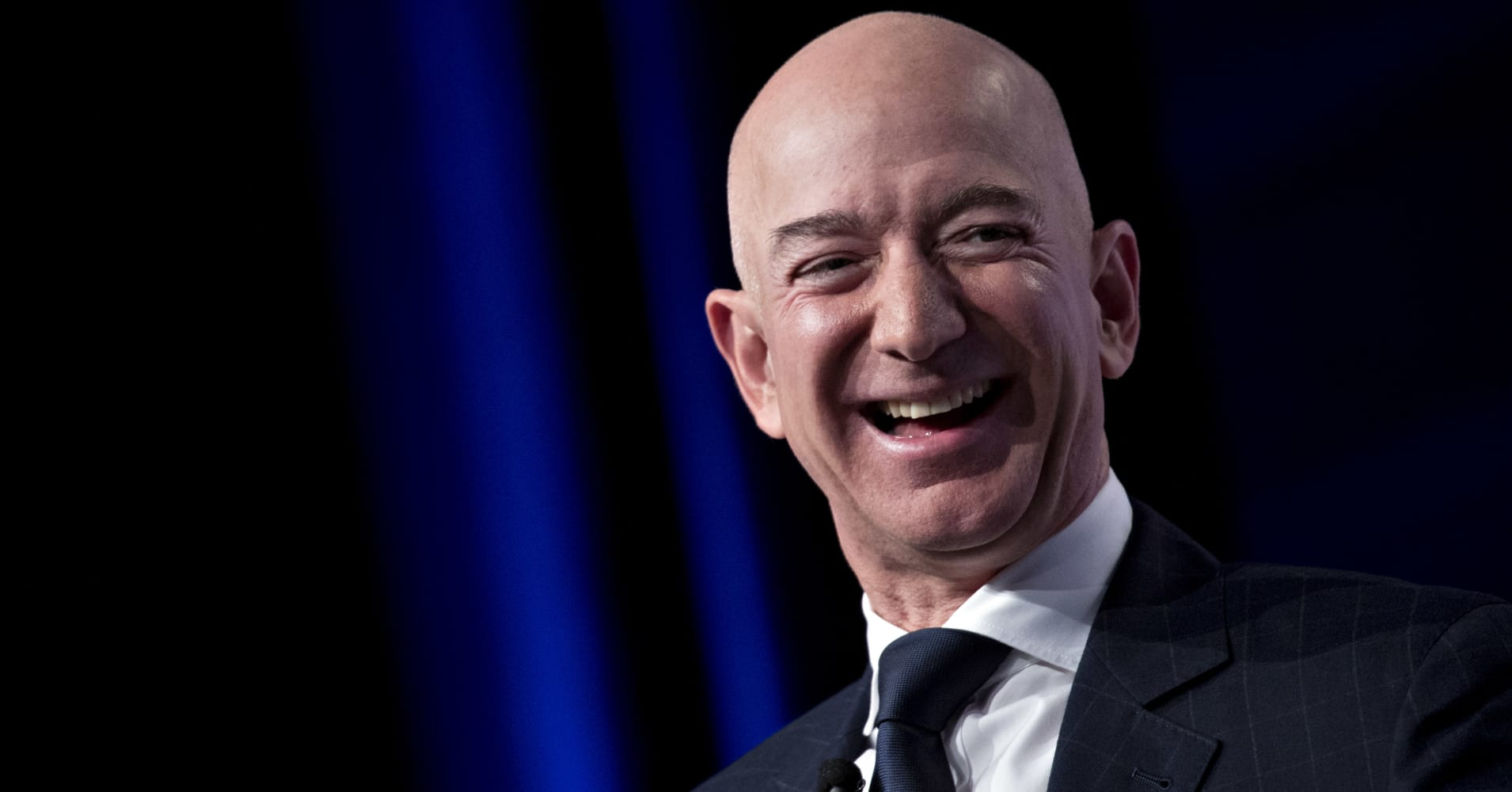 Amazon CEO Jeff Bezos laughs at a discussion at the Air Force Association's Air, Space and Cyber Conference in National Harbor, Md., Sept. 19, 2018.