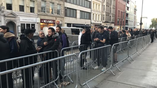 Shoppers queue up outside Apple's store in Regent Street, London, for the new iPhone models.