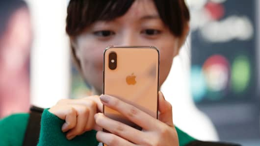 A customer looks at Apple's new iPhone XS after it went on sale at the Apple Store in Tokyo, Japan, September 21, 2018.
