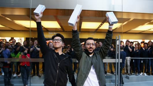 Teddy Lee and  Mazen Kourouche pose with their  iPhone Xs  during the Australian release of the latest iPhone models at Apple Store on September 21, 2018 in Sydney, Australia.