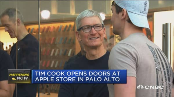 Tim Cook visits Apple Store as new iPhones on sale