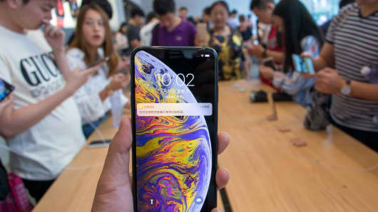 A customer shows his iPhone XS Max during the launch of iPhone XS and iPhone XS Max at an Apple Store in Nanjing East Road on September 21, 2018 in Shanghai, China.