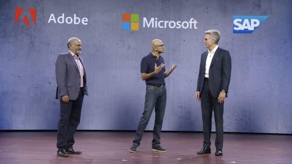 Adobe CEO Shantanu Narayen, Microsoft CEO Satya Nadella and SAP CEO Bill McDermott announce the Open Data Initiative at Microsoft's 2018 Ignite conference in Orlando, Florida.