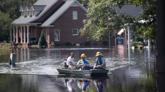 People navigate floodwaters caused by Hurricane Florence near the Waccamaw River on September 23, 2018 in Conway, South Carolina.