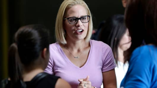 Senate candidate Kyrsten Sinema speaks with volunteers in Phoenix in August.