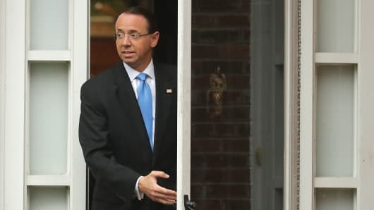 Deputy Attorney General Rod Rosenstein leaves his home on September 25, 2018 in Bethesda, Maryland. Presuming his time at the Justice Department was in jeopardy, Rosenstein met Monday with White House Chief of Staff John Kelly but was told to stay on the job at least until Thursday when they will meet with President Donald Trump.