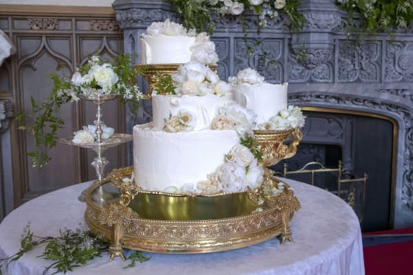 The wedding cake by Claire Ptak of London-based bakery Violet Cakes is pictured in Windsor Castle for the wedding of Britain's Prince Harry, Duke of Sussex and Meghan Markle on May 19, 2018. The wedding cake features elderflower syrup made at The Queen's residence in Sandringham from the estates own elderflower trees, as well as a light sponge cake uniquely formulated for the couple. A filling made from Amalfi lemon curd and elderflower buttercream ties all the elements together. The cake is decorated with Swiss meringue buttercream and 150 fresh flowers, mainly British and in season, including peonies and roses.