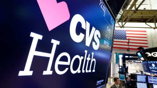 The CVS Health logo appears above a trading post on the floor of the New York Stock Exchange.