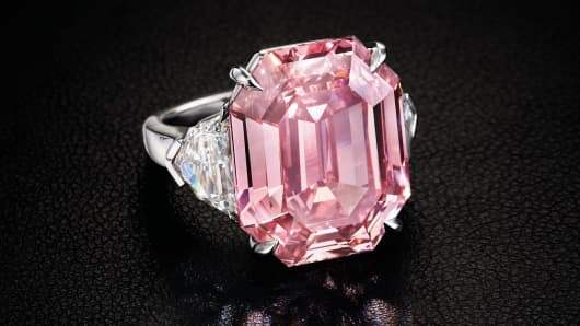 The 18.95 carat, fancy vivid pink stone is a rectangular cut and is called The Pink Legacy.