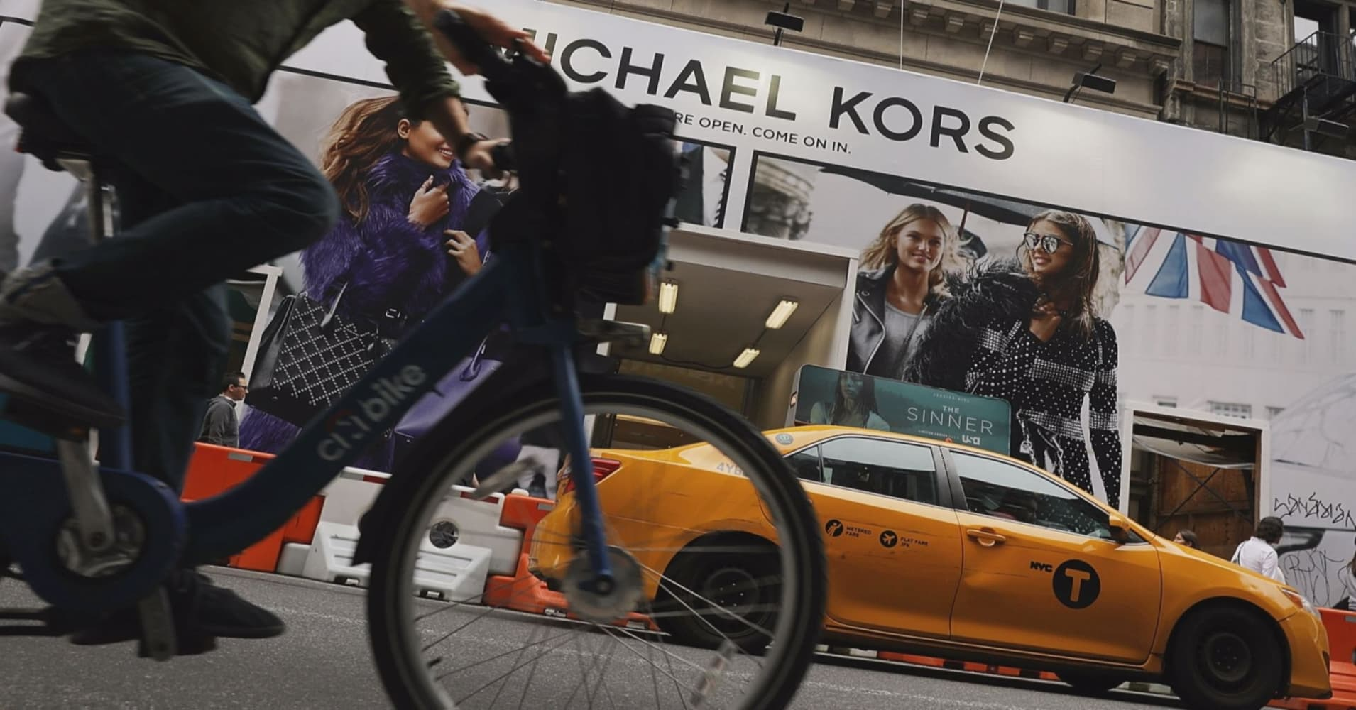 Michael Kors to buy Versace for about $2.1 billion