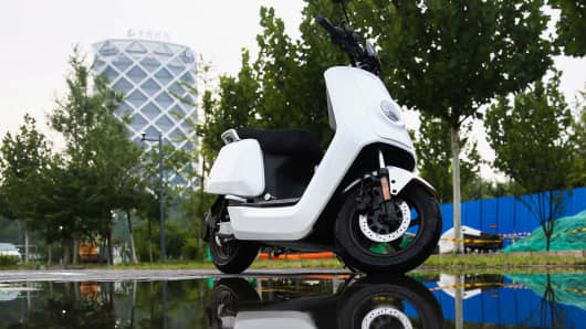 An electric-scooter of Niu Technologies Group Ltd. is displayed on a road in Beijing, China, 11 August 2018.