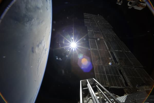 The sun and Earth out the window of the International Space Station. Photograph taken by Richard Garriott.