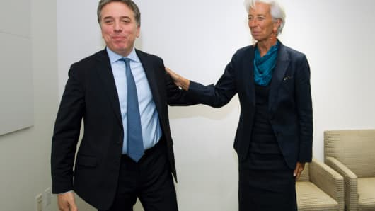 International Monetary Fund  Managing Director Christine Lagarde (L) meets with Argentina's Economy Minister Nicolas Dujovne (R) at IMF Headquarters, on September 4, 2018, in Washington, DC.