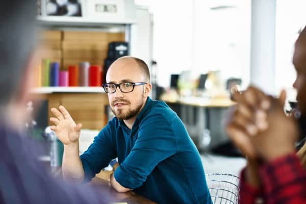 Man talking at business meeting in modern conference room