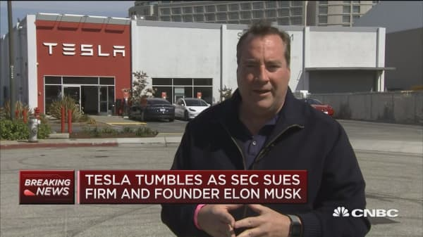 Tesla tumbles after SEC announces fraud charges