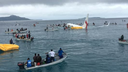People are evacuated from an Air Niugini plane crashed in the waters in Weno, Chuuk, Micronesia, September 28, 2018 in this picture obtained from social media.