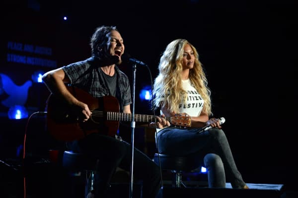 Eddie Vedder and Beyonce perform onstage during 2015 Global Citizen Festival to end extreme poverty by 2030 in Central Park on September 26, 2015 in New York City.
