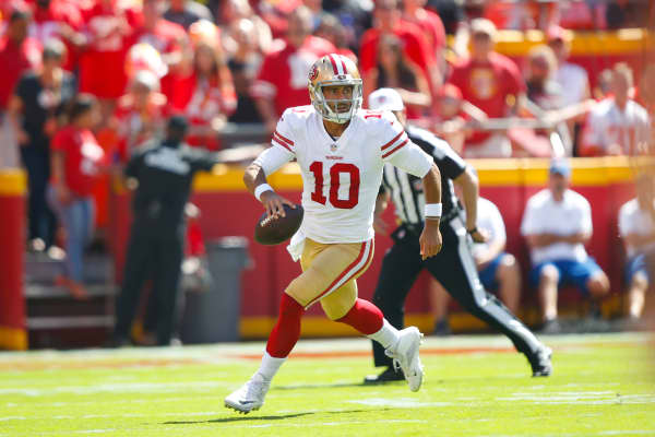 Jimmy Garoppolo #10 of the San Francisco 49ers scrambles during the game against the Kansas City Chiefs at Arrowhead Stadium on September 23, 2018 in Kansas City, Missouri.