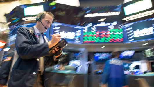 Traders work on the floor at the opening bell of the Dow Industrial Average at the New York Stock Exchange on September 28, 2018 in New York.