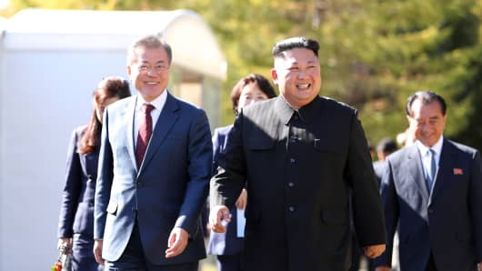 North Korea's leader Kim Jong Un (R) walks with South Korean President Moon Jae-in (L) during a visit to Samjiyon guesthouse on September 20, 2018 in  North Korea.