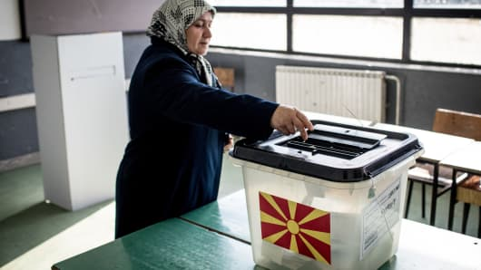 A woman casts her vote at a polling station on September 30, 2018 in Tetovo, Macedonia. Macedonians all across the country went to the polls on Sunday to vote in a referendum to change the country's name to the 'Republic of North Macedonia' and end a long running dispute with Greece.