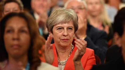 BIRMINGHAM, ENGLAND - SEPTEMBER 30:  British Prime Minister Theresa May applauds as she sits in the audience during the annual Conservative Party Conference on September 30, 2018 in Birmingham, England.