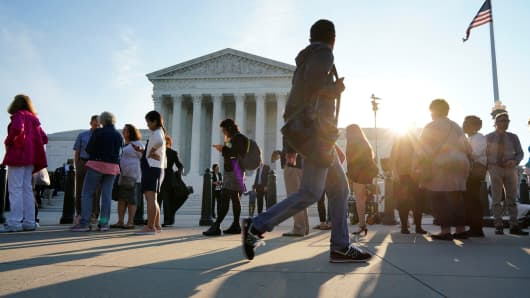 People wait in line to attend the opening day of the new term of the Supreme Court in Washington, October 1, 2018.