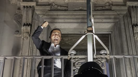 Luigi Di Maio, Italy's deputy prime minister, celebrates on the balcony of the Chigi palace following the presentation of the budget targets at a cabinet meeting in Rome, Italy, on Thursday, Sept. 27, 2018.
