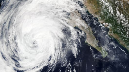 Tropical Storm Rosa nears the Baja Peninsula on Mexico's west coast in this September 30, 2018 handout satellite image.