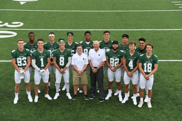 Dartmouth College football coach Callie Brownson with Coach Dave Shula and some of Dartmouth's wide receivers.