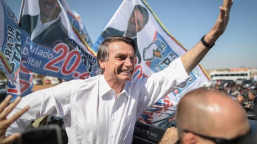 Jair Bolsonaro, presidential candidate for the Social Liberal Party (PSL), waves to supporters during a campaign rally in Taguatinga, Brazil, on Wednesday, Sept. 5, 2018.