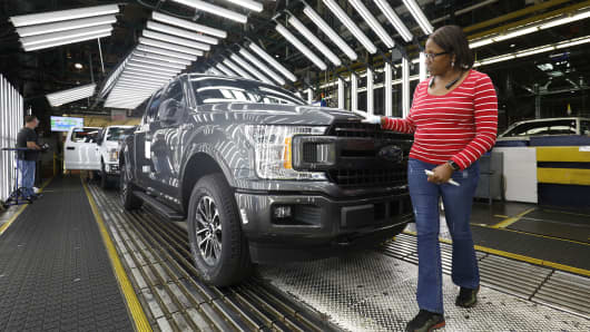 Ford F-150 trucks go through the customer acceptance line at the Ford Dearborn Truck Plant on September 27, 2018 in Dearborn, Michigan.