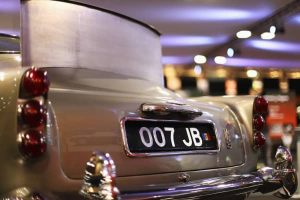 A license plate view of the 1964 Aston Martin DB5 James Bond movie car.