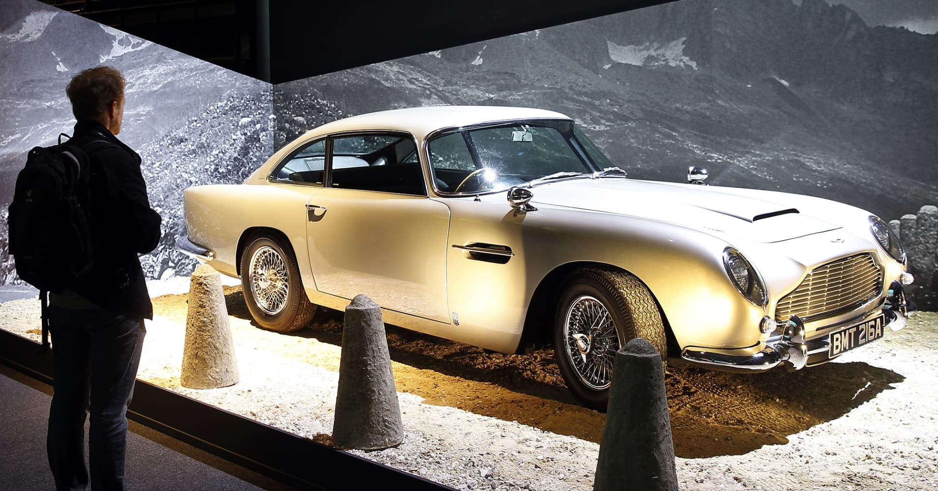Aston Martin DB5 from the James Bond film 'Goldfinger' is displayed as part of an exhibition dedicated to James Bond 007 'The Designing 007: Fifty Years of Bond Style' at the Grande Halle de la Villette on April 16, 2016 in Paris, France.