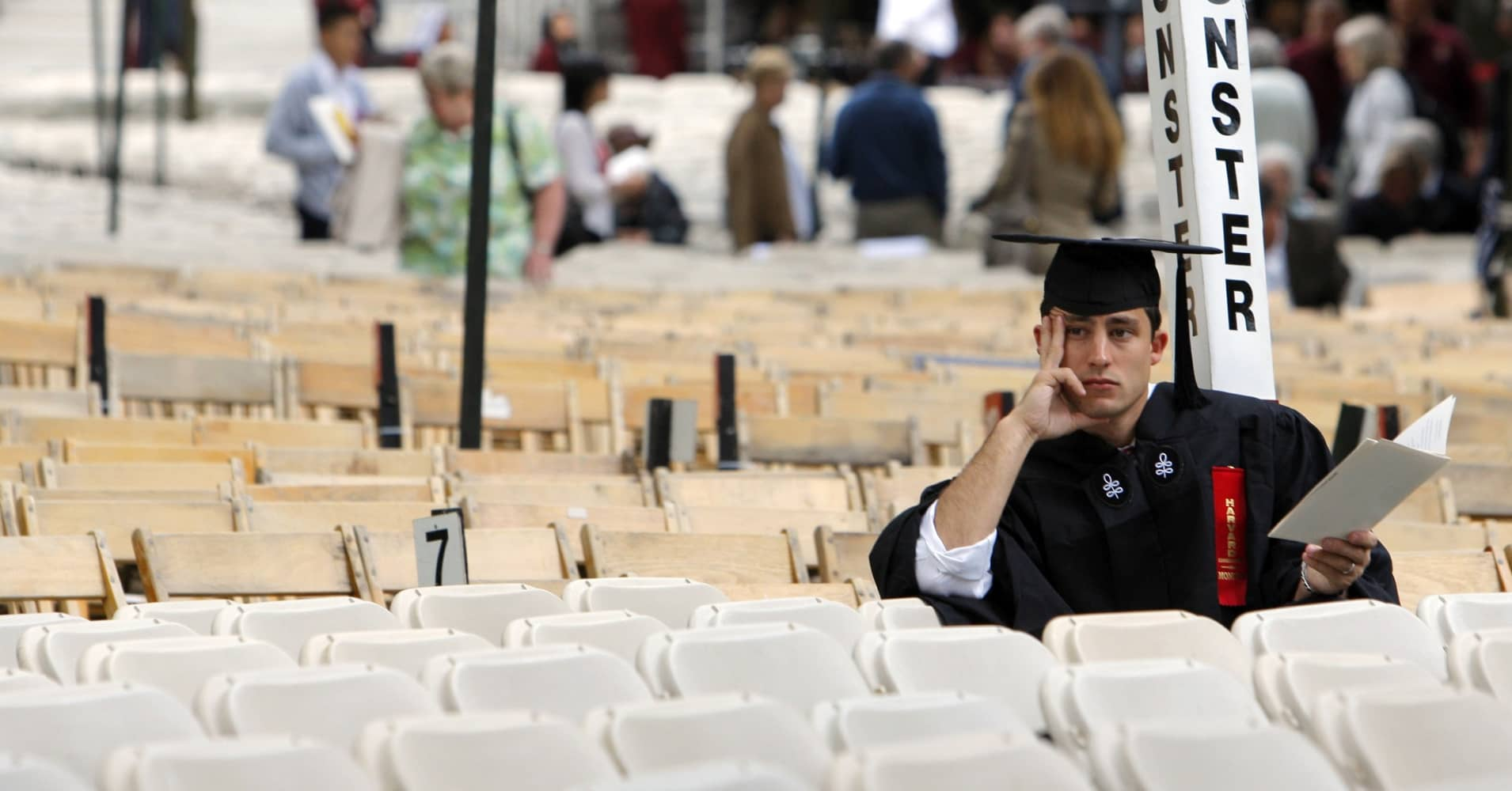 A graduating student waits for the start of Harvard University's Commencement Exercises.