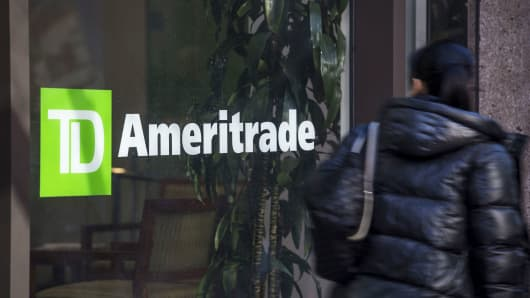 A pedestrian passes in front of a TD Ameritrade Holding Corp. location in San Francisco, California.