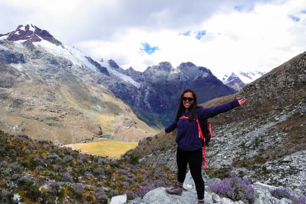 Solo female traveler Xin'en Chua trekking in Huaraz, Peru as part of her two-year travel trip.
