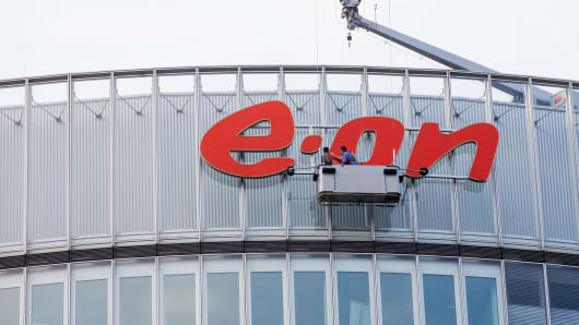 The logo on the outside of eon headquarters being cleaned.